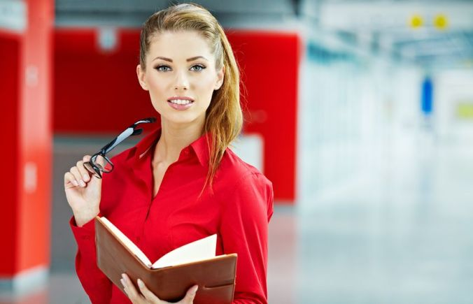 15313999 - business woman holding glasses and looking at camera. copy space